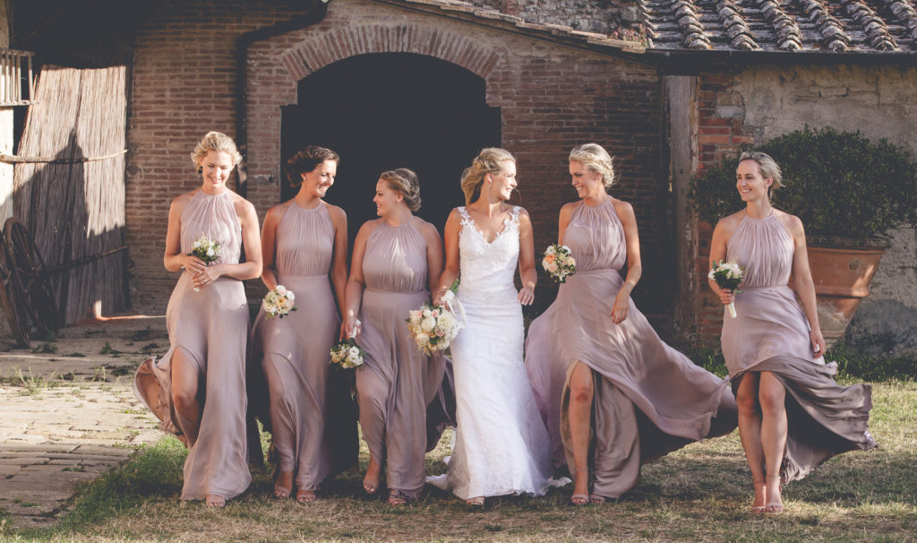 Happy brides maids beside the bride at a wedding in Italy Tuscany, Wedding Photography by Couture Wedding Films